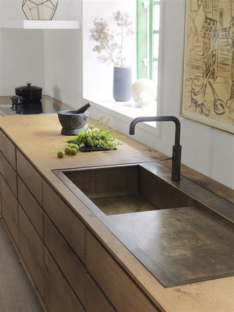 'Model Dinesen' bespoke wooden kitchen with browned brass